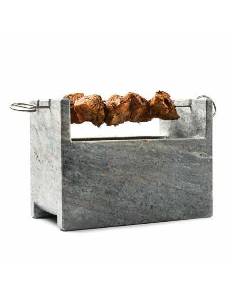 Barbacoa de piedra para cocinar al carbón